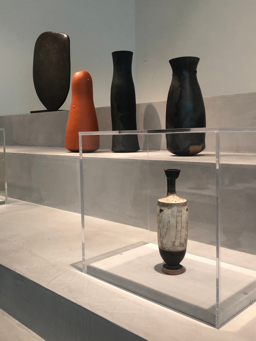 Rear left: model for 'Single Form', Barbara Hepworth; centre: three kigango vases, Magdalene Odundo; front, white-ground lekythos, Athens, fourth century BCE.