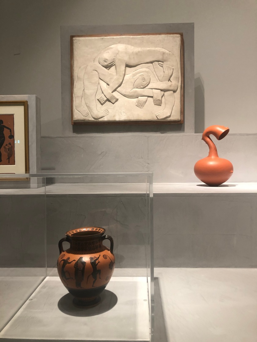 Wrestlers bas relief, red vase by Magdalene Odundo, archaic black-figure Athenian amphora