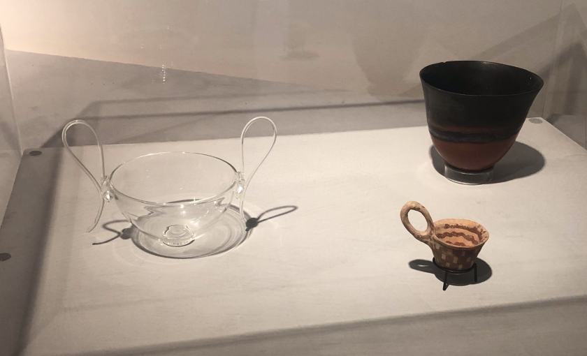 Three drinking vessels: from left to right 'Drinking Vessel', Magdalene Odundo, 2000; dipper bowl, Crete, c. 1900-1650 BCE; beaker, Kerma culture, Nubia (Egypt) 1173-1650 BCE.