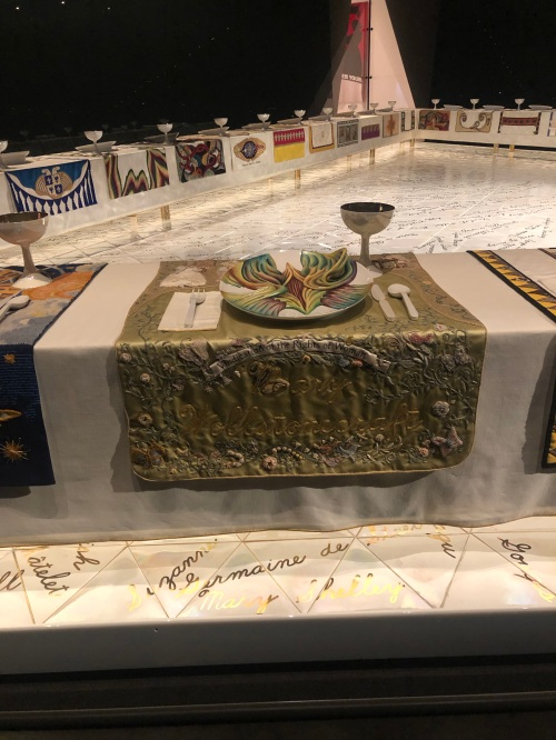 Mary Wollstonecraft place setting in Judy Chicago's The Dinner Party, with plate and embroidered table runner