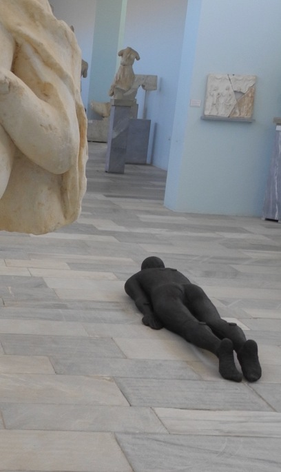 Shift II (2000) lying prone in the main gallery of the Delos museum.