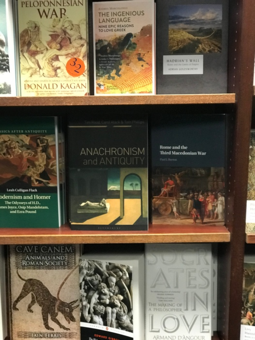 Anachronism and Antiquity book with other books on the display bookshelves in Oxford.